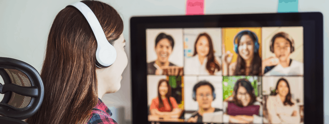 Student wearing headset, talking to other students in video chat